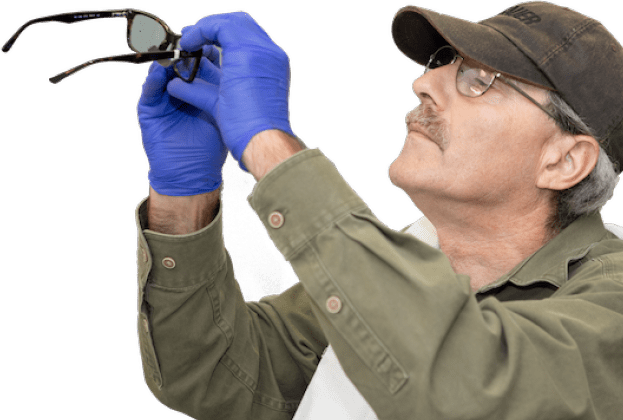 technician inspecting new eyeglasses