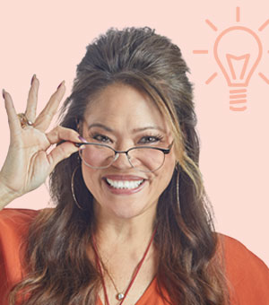 "woman wearing glasses with an ""idea"" lightbulb above her head"